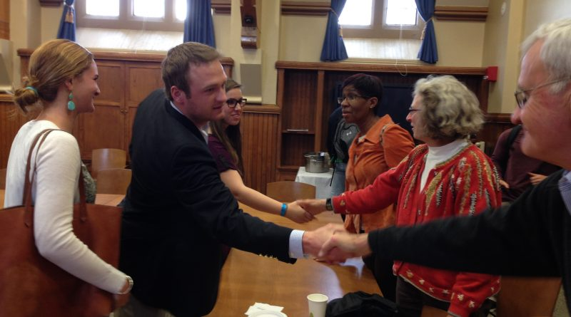 """Trinity College students shake hands with community partners following their final presentation for """"Diversity in the City."""""""