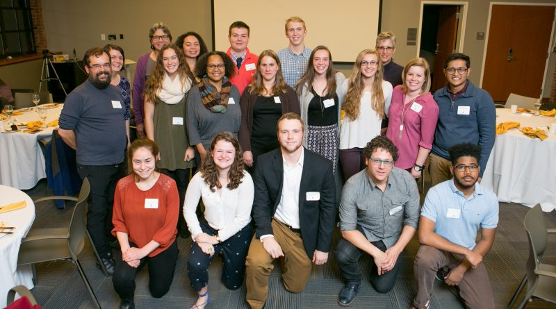Students, Faculty, and Community Partners gather after the Community Gateway Dinner for a photo