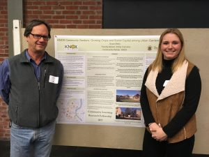 At the Research Fellows presentations, Grace Metry '18 stands in front of her poster with Ron Pitz of Knox, Inc., her community partner