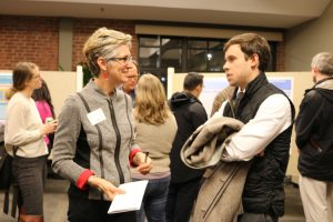 Professor Carol Clark and David Lavery, Connecticut Fair Housing, chat at the Dec. 2017 Research Fellows presentations.