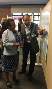 Daisuke Katsumata, IDP, explains his project on feedback and metacognition for high schoolers to President Joanne Berger-Sweeney.