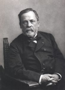 Louis Pasteur seated