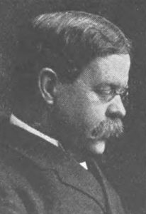 Portrait of man with glasses and mustache