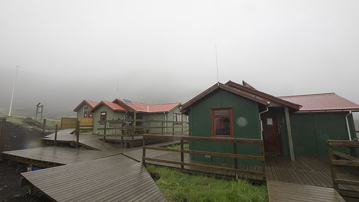 A common sight: our hut in the morning rain.