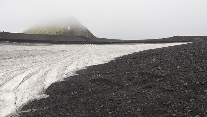 Low-hanging clouds hide some of the most impressive volcanic peaks.