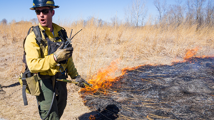 Chad Graeve, the instructor points out the finer points of a grass fire.
