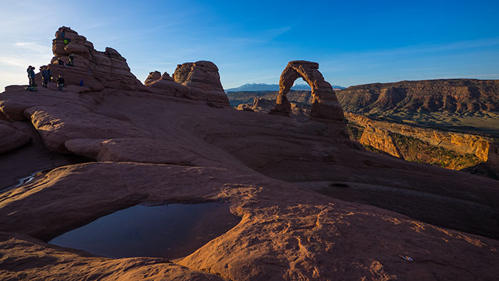 Delicate Arch at sunrise. Yep, that little figure in neon green, close to the highest spire is Adam.