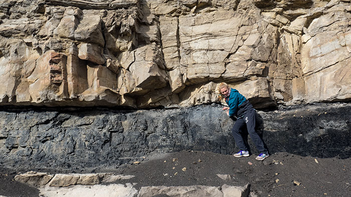Lauren pointing out a coal seam in Price Canyon