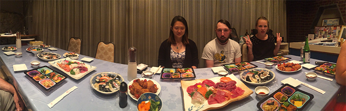 A meal so grand it needed a panoramic.  Trinity students enjoy a feast from the Kato family at Hotel Boyo.