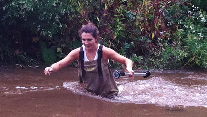 Sarah Black ('18) braving the Park river to take stream flow measurements.