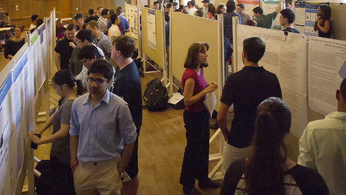Students presenting the results of their summer research at the Science Symposium