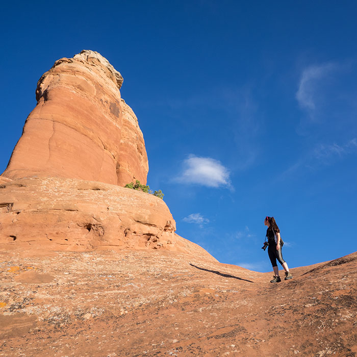 Cassia sizing up the red rock - Arches National Park, 2015
