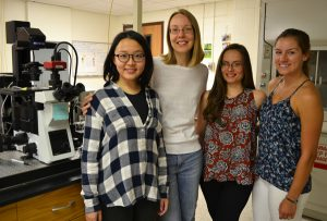 Kunwei Yang '17, Trinity College Assistant Professor of Chemistry Michelle Kovarik, Kathy Rodogiannis '17, and Allison Tierney '17 in Kovarik's lab.
