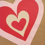Book wrapped in brown paper, red heart decoration