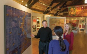 Victor Keen '63 and his wife, Jeanne Ruddy, show a visitor around the Bethany Mission Gallery.