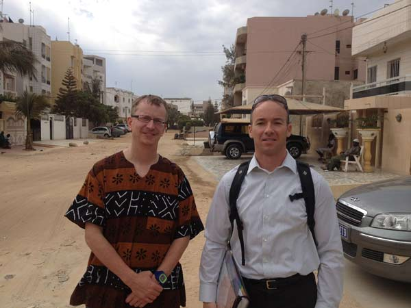 Professor Garth Myers (left) tours the streets of Dakar, Senegal, with Major Tom Hanlon of the United States Military Academy at West Point during a study-abroad trip the two led for West Point students last winter.