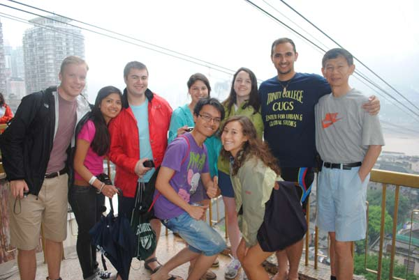 A group from Trinity gathers on the platform of the cable car across the Yangtze River in the City of Chongqing, China, in June 2012. Front row: Nicky Thai '15, Mariah Wachtman '15; back row: Duncan Grimm '15, Hanh Linh Ho '15, Dominic Carbone '15, Rosangelica Rodriguez '15, Avery Dwyer '14, Gaurav Toor '14, Professor Xiangming Chen