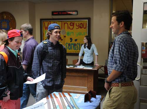 Mike Lofrese '16 and Carter Reynolds '16 talk with Alex Stroud '13 about his La Matera belts.