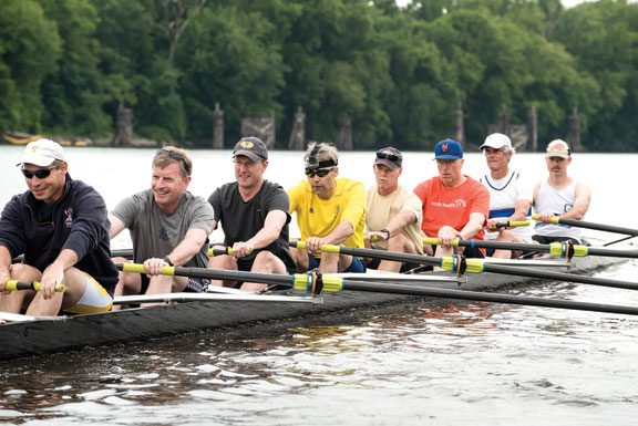 Former members of the men's rowing team participate in the Alumni Row at the Trinity Rowing Boathouse in Hartford. Enjoying the day are Eric Rosow '86, Jay Manson '86, Andy Merrill '85, Bob Rochelle '84, Bob Reichart '84, Peter Van Loon '78, Steve Hamilton '70, and Scott Goldsmith '90