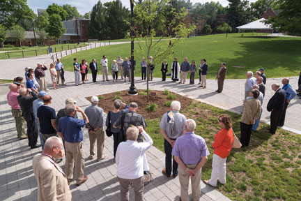 Friends and family gather at the Watkinson Library courtyard for the dedication of a locust-tree planting in memory of Peter Knapp '65, P'10, former College archivist and special collection librarian.