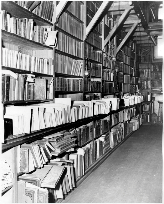Watkinson stacks are overflowing in the Wadsworth Atheneum in 1950.
