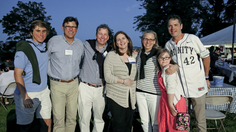 Guy Thomas, William Thomas '86, P'20, A.J. Hern '86, Margaret Figueroa Hern '86, Heather Moody Thomas '86, P'20, Jane Thomas, and Jay Gangi '86 enjoy the New England-style clambake on the Main Quad. About 500 alumni and their family members attended the Friday night event.