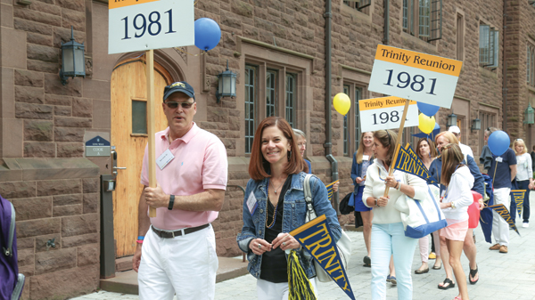 Rob Aiello '81 and Eleanor Wenner Kerr '81, P'13 lead the Parade of Classes down the Long Walk for the Class of 1981.