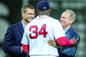 September 21, 2015, Boston, MA: Boston Red Sox designated hitter David Ortiz hugs Chief Executive Officer Sam Kennedy and President & CEO Larry Lucchino during a ceremony recognizing his 500th career home run before a game against the Tampa Bay Rays at Fenway Park in Boston, Massachusetts Monday, September 21, 2015. (Photos by Billie Weiss/Boston Red Sox)