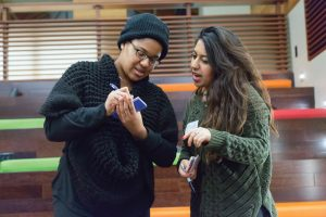 Posse Scholar Ainslya Charlton '16 and Alicia Abbaspour '18 engage in an activity at the January leadership summit.