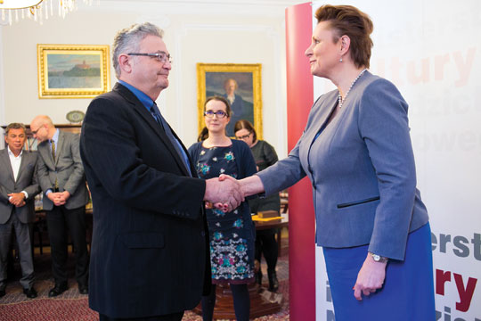 Polish Minister of Culture and National Heritage Malgorzata Omilanowska, right, congratulates Sam Kassow '66, Charles H. Northam Professor of History, on receiving an Order of Merit for Contribution to Polish Culture. The ceremony took place in Warsaw on February 16, 2015.