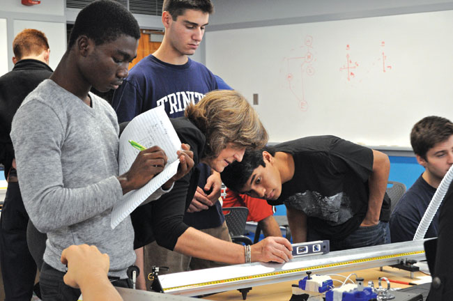 Associate Professor of Physics Barbara Walden and her students gather data.