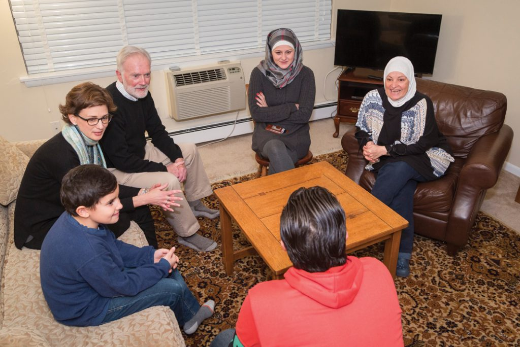 Trinity College Chaplain Allison Read, Drew Smith '65, and Maryam Bitar IDP'16 talk with the Syrian family that came to the United States under the co-sponsorship of the College and Hartford's Trinity Episcopal Church communities.