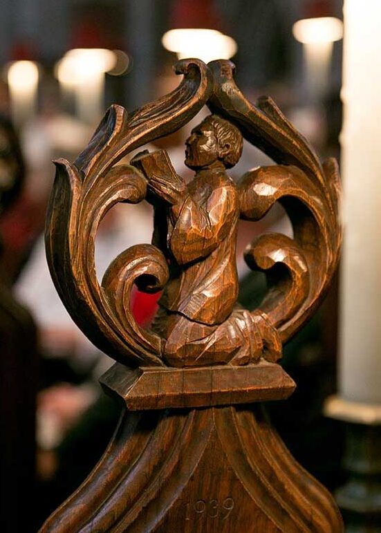 An intricately carved pew end