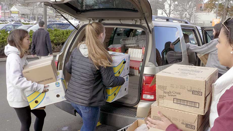 Trinity students load donations for the 2018 Thanksgiving Drive