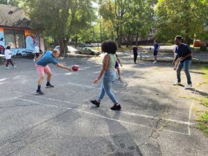 Men of Color Alliance (MOCA) barbecue attendees play four square during the 2019 event at Trinfo.Café.