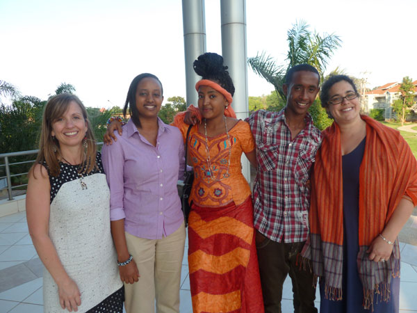 Trinity Associate Director of Admissions Mandi Haines and Trinity Associate Professor of Political Science Stefanie Chambers, right, join MasterCard Foundation Scholars Tracy Keza, Fatty Al Ansar, and Nasri Abdilahi, all members of the Class of 2017, at the United States International University in Nairobi, Kenya, in May 2013.