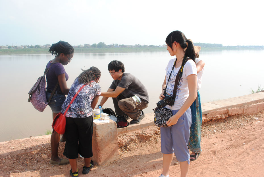 As part of Trinity's River Cities of Asia program in summer 2013, Sakile Broomes '16, Salima Etoka '15, Daniel Luke '14, and Mona Deng '16 analyze water samples from the Mekong River in Vientiane, the capital city of Laos. Professor of Biology Joan Morrison is behind Deng. Photo by Xiangming Chen