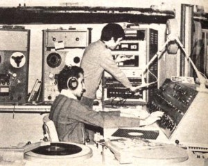 On-air teamwork: Host Howard Goldstein (left) makes an adjustment on the control board while Jack Santos turns on a public service announcement in 1974. Despite being blind, Goldstein was on the WRTC staff for many years.