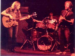 Alien Rock brings 'em In: Bill Rea (left), Doug Landsberg and renowned guitarist Glenn Phillips appeared at Trinity in 1978.