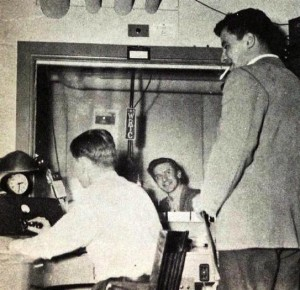 Stand by!: Advertising manager Fred Campbell (right) talks with engineer Red Thomas and announcer John Paddon (center) in 1949.