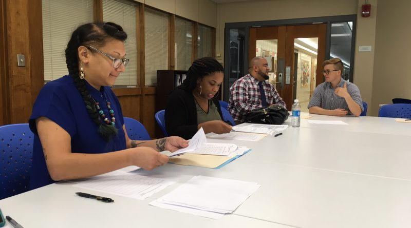 Hartford Resident Advisory Board sits around a table and discusses Action Lab proposals.