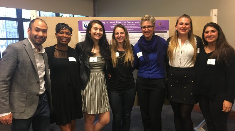 Spring 2018 Research Fellows presenters stand smiling with Professor Carol Clark at the end of their successful poster presentations!