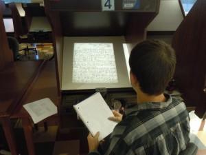 Michael McLean examines archives at the Oklahoma Historical Society.