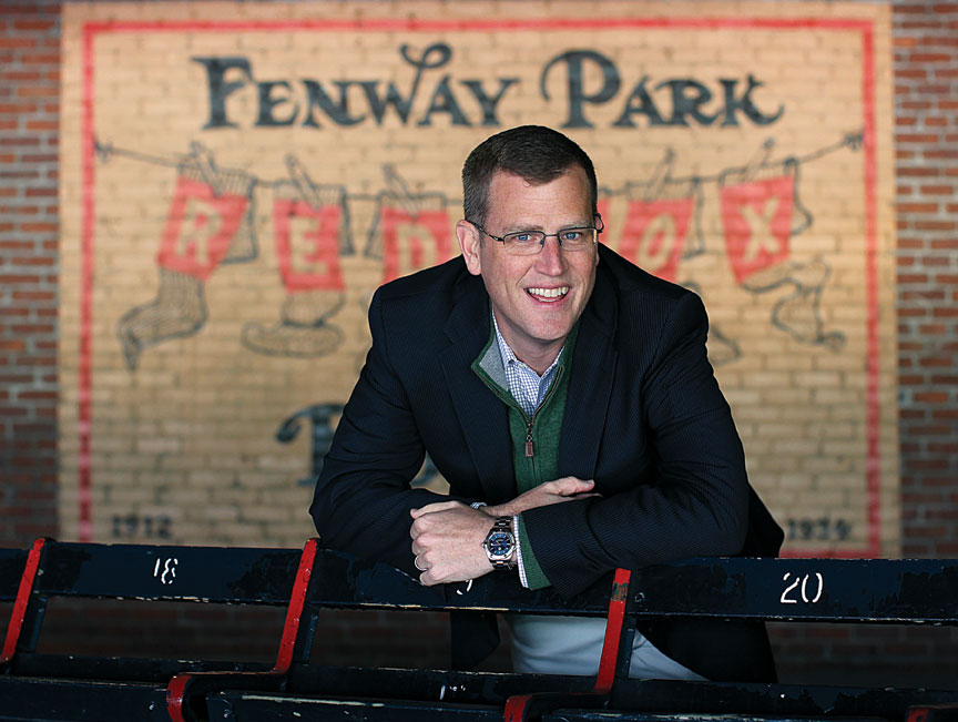 On The Cover: Sam Kennedy '95, president of the Boston Red Sox, at Fenway Park (Photo: Suzanne Kreiter/The Boston Globe Via Getty Images)