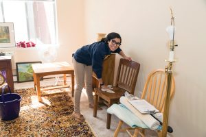 student setting up an apartment for refugees